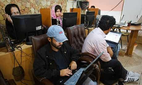 Customers at a Tehran internet cafe