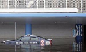 A police car in a flooded parking lot of Acapulco international airport.