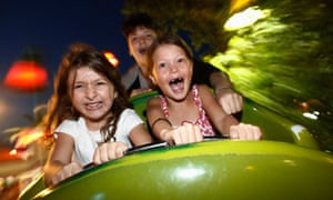 Children on a rollercoaster ride at Luna Park, Athens.