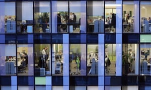 Workers in offices at dusk in London