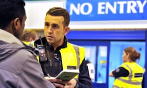 UK Border Agency officials question people