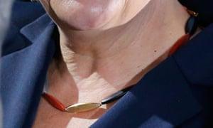German Chancellor Merkel wears necklace
