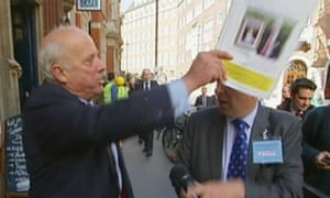 odfrey Bloom hits journalist Michael Crick with a party  conference brochure