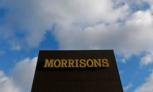 A Morrisons sign is seen outside a supermarket in London