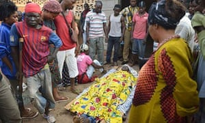 Bengui Central African Republic eople surround the body of a man killed