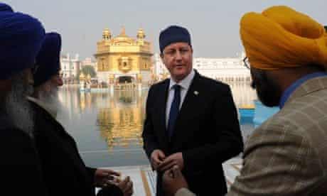 David Cameron visiting the Golden Temple at Amritsar last year