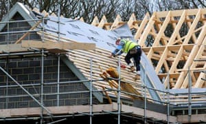 House building: builder on roof