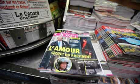 French magazines and newspapers with headlines about Hollande's affair