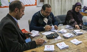 supervisors count votes at a polling station