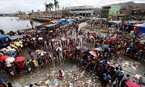Victims queue for food and water after super typhoon Haiyan in Tacloban city, Philippines