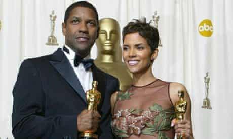 Oscar winners Halle Berry and Denzel Washington in 2002.