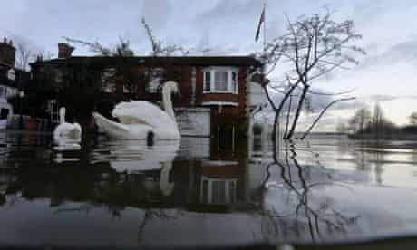 Henley-on-Thames riverside properties partially submerged in floodwaters