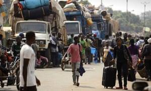 Muslim civilians prepare to board trucks in Bangui to flee violence