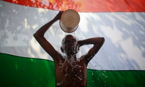 A man takes a bath outside his shanty in Dharavi, one of Asia's largest slums, in Mumbai
