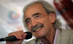 Juan Gelman, Argentinian poet, with microphone at a conference