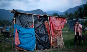 Ramon Mundia and his makeshift home in Bajo Aguan Valley