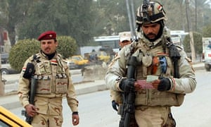 Iraqi soldiers monitor a checkpoint east Baghdad