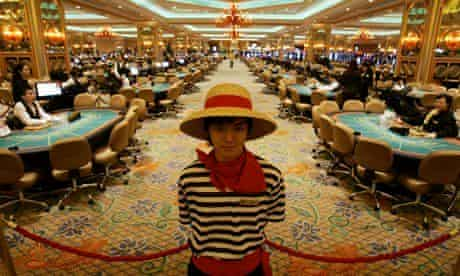 Gambling tables inside the casino at the Venetian Macao Resort Hotel.