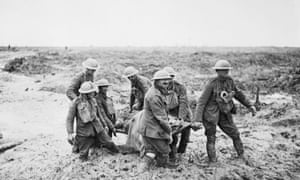 Battle of Passchendaele, first world war: stretcher bearers in deep mud carry a soldier to safety