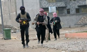 Gunmen patrol during clashes with Iraqi security forces in Falluja, Iraq