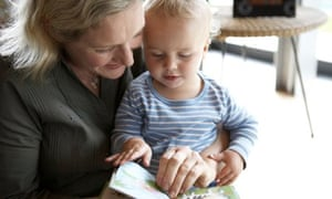 Mother and baby son (18-21 months) looking at book