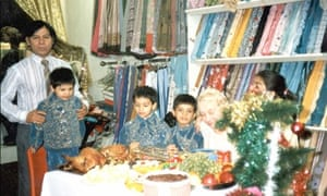 The family celebrating Christmas in Fatima's shop.