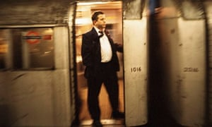 A Train Guard on the old Northern Line trains by Antonio Olmos