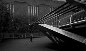 A man walks between the Millenium Bridge and the tate Modern Art Gallery in London Antonio Olmos