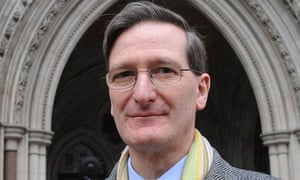 Dominic Grieve QC in an overcoat and yellow scarf outside the Court of Appeal in central London