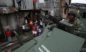 A Colombian soldier patrols in a poor neighbourhood of Buenaventura