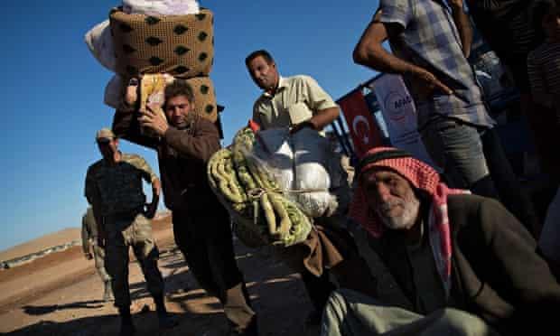 Refugees flee Syria into Turkey as Isis advances on Kobani