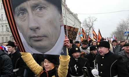 Russians attend a rally in Moscow to support Vladimir Putin with the invasion of Crimea