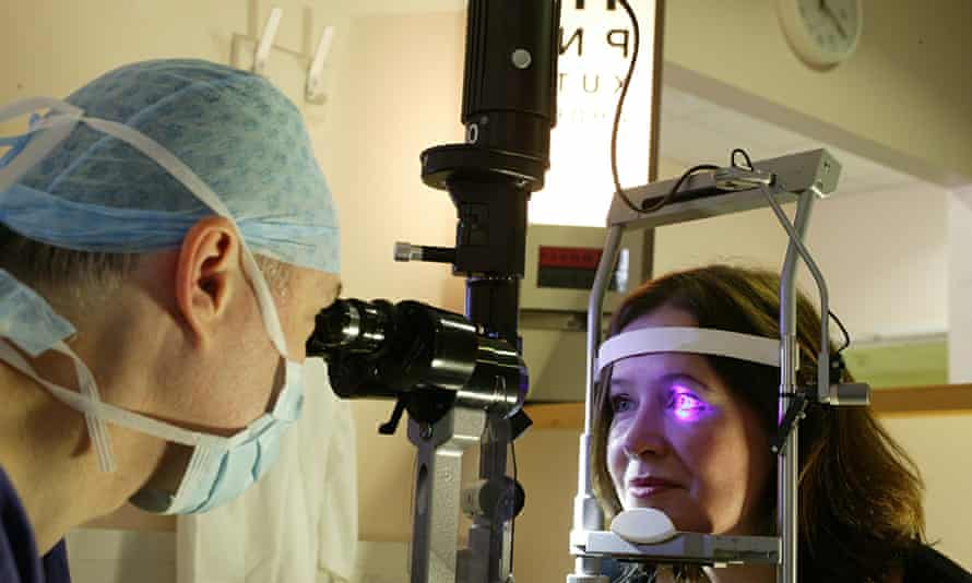 A woman undergoes an eye examination