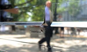 Man walks past Credit Suisse in Berlin