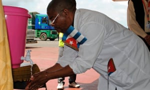 Cuban health worker washes his hands