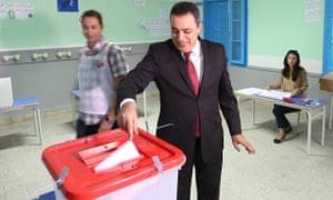 Tunisian PM Jomaa casts ballot for parliamentary election
