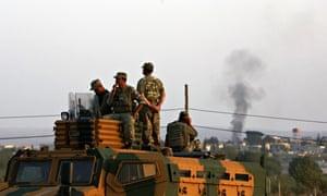 Turkish soldiers watch mortar shell smoke rises Kobani