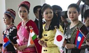 Burmese women dressed in traditional costume greet the heads of state