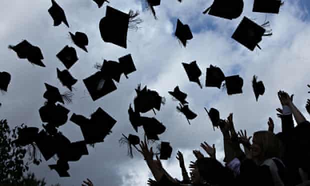 Mortarboards are tossed in the air