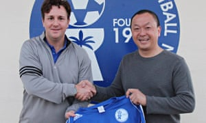 Gary White (left) was enticed to Guam by its FA president, Richard Lai, and the partnership has blos
