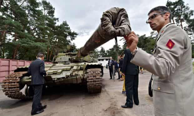 A military attache examines a Russian T-64BV tank seized in August during fighting in eastern Ukrain