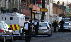 Police patrol Springfield Road, West Belfast