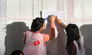 Tunisian electoral officials at a vote-counting centre in Tunis.