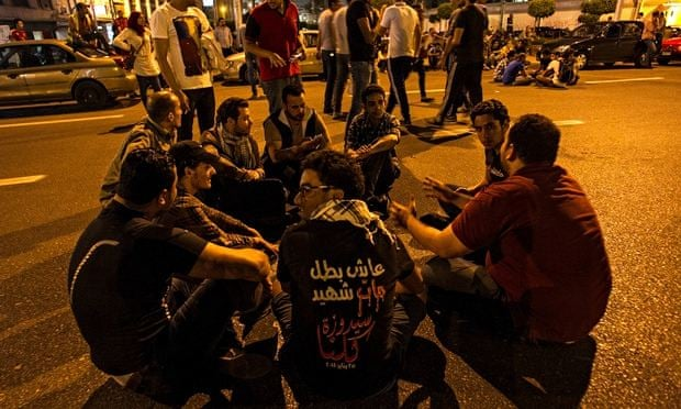 Young men demonstrate in Cairo, Egypt, against the protest law