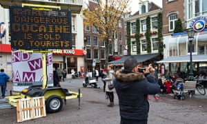 An electronic warning sign in central Amsterdam: 'Extremely dangerous cocaine is sold to tourists.'
