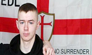 Ryan McGee in front of an EDL flag