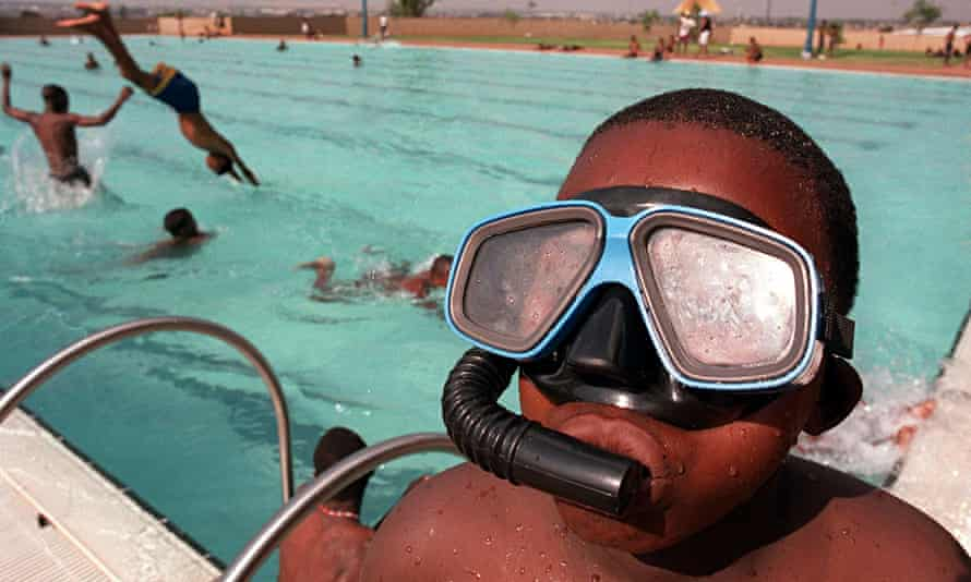 Child wearing snorkel and goggles