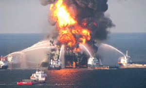 Boat response crews battling the blazing remnants of the offshore oil rig Deepwater Horizon