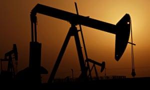 Oil pumps at sunset in Sakhir, Bahrain