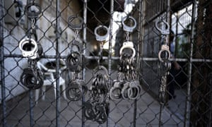 Handcuffs hang from a gate